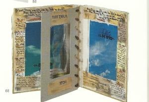"""G: GINI: """"Flight test"""", Libro oggetto, 19x16,3. 2 pagine centrali con foto, scritture e timbri. Pagina centrale a finestra con piuma. Unicum 2013. Foto di chiara Luxardo"""
